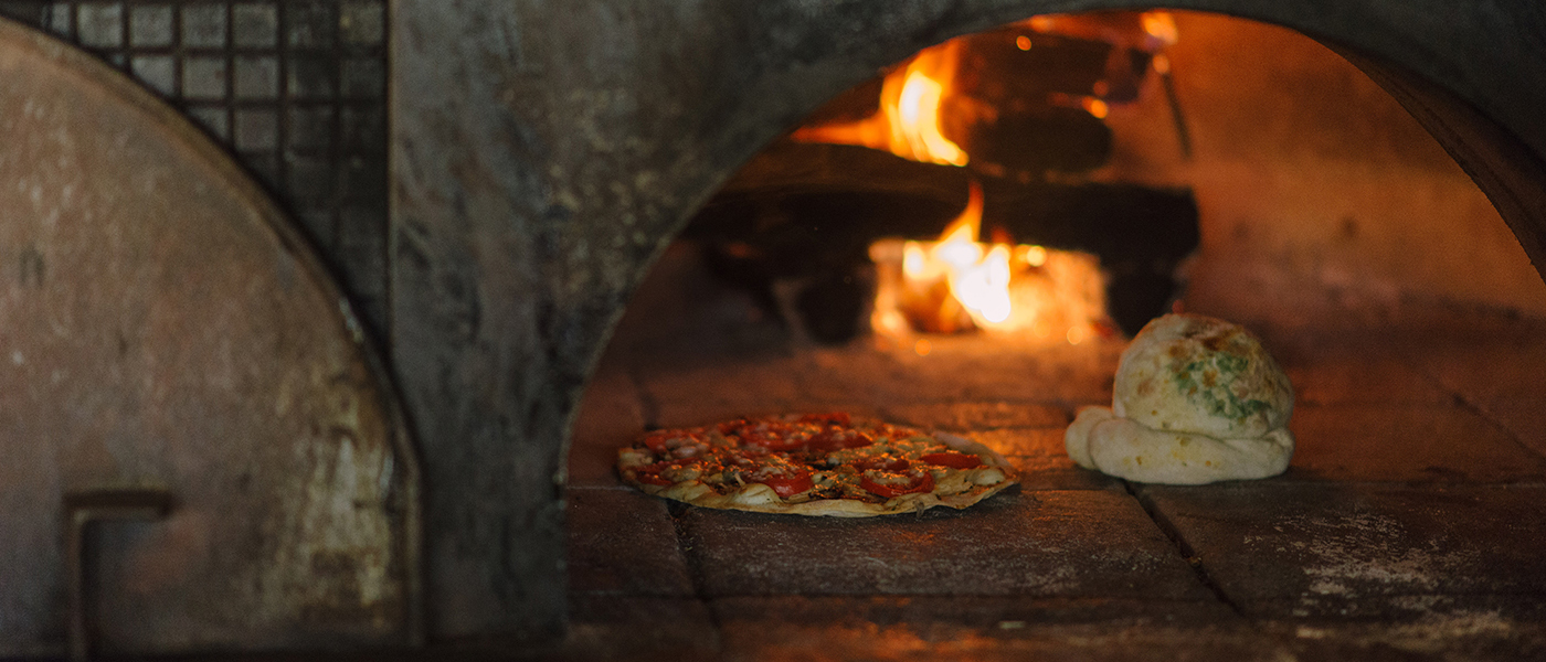 WOOD-FIRED PIZZAS & CALZONES